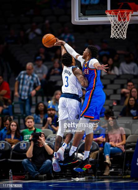 Justin Patton of the Oklahoma City Thunder blocks the ball during a pre-season game against the Dallas Mavericks on October 14, 2019 at American...