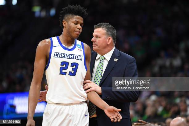 Justin Patton speaks with Head coach Greg McDermott of the Creighton Bluejays against the Rhode Island Rams during the first round of the 2017 NCAA...