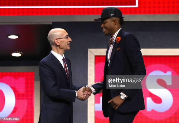 Justin Patton walks on stage with NBA commissioner Adam Silver after being drafted 16th overall by the Chicago Bulls during the first round of the...