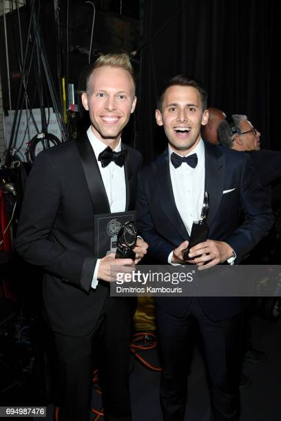 Justin Paul and Benj Pasek pose backstage with their Tony awards for Best Original Score during the 2017 Tony Awards at Radio City Music Hall on June...
