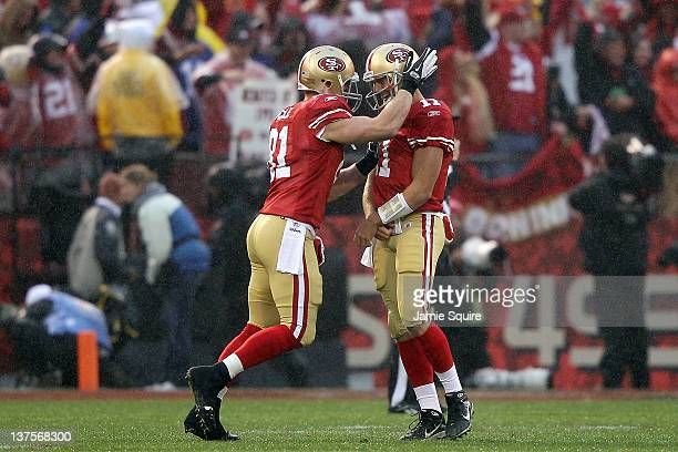 Justin Peelle and Alex Smith of the San Francisco 49ers celebrate after Vernon Davis of the San Francisco 49ers scored on a 73yard touchdown...
