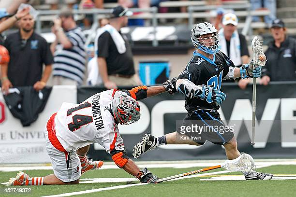 Justin Pennington of the Denver Outlaws attempts to check Bobby Dattilo of the Ohio Machine during the fourth quarter on July 26 2014 at Selby...