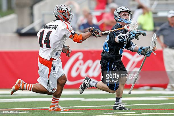 Justin Pennington of the Denver Outlaws checks Bobby Dattilo of the Ohio Machine during the fourth quarter on July 26 2014 at Selby Stadium in...