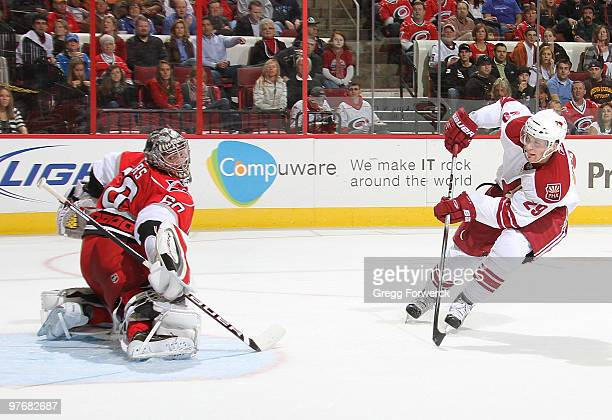 Justin Peters of the Carolina Hurricanes deflects a breakaway shot by Lauri Korpikoski of the Phoenix Coyotes during a NHL game on March 13 2010 at...