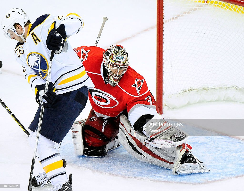 Justin Peters #35 of the Carolina Hurricanes stops a shot as he is screened by Thomas Vanek #26 of the Buffalo Sabres during play at PNC Arena on March 5, 2013 in Raleigh, North Carolina. The Hurricanes won 4-3.