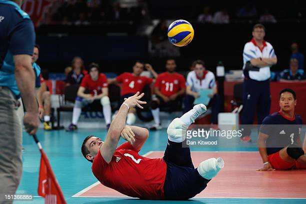 Justin Phillips of Great Britain plays a shot during the Men's Sitting Volleyball 78 Clasification match against Brazil on day 8 of the London 2012...