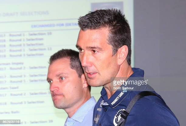Justin Reid List Manager of the Crows and Stephen Silvagni List Manager of the Blues arrive together to attend the AFL Draft Period at Etihad Stadium...