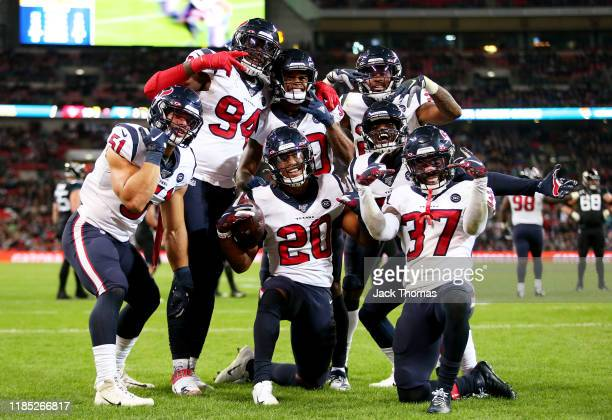 Justin Reid of the Houston Texans celebrates with teammates after making an interception during the NFL match between the Houston Texans...