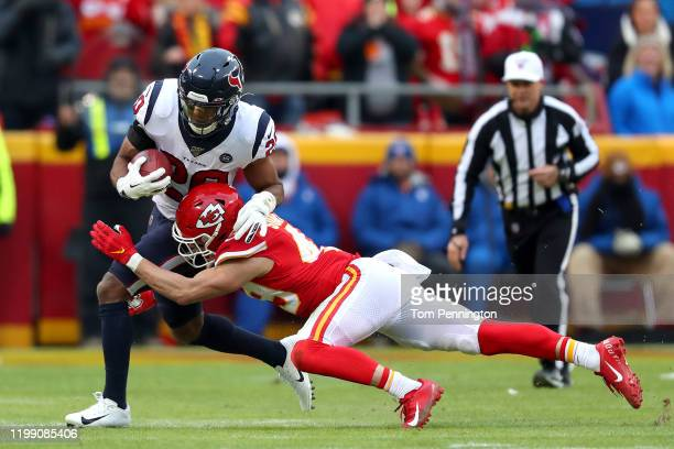 Justin Reid of the Houston Texans is tackled by Daniel Sorensen of the Kansas City Chiefs on a fake punt attempt during the second quarter in the AFC...