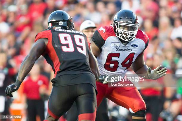 Justin Renfrow of the Calgary Stampeders gets set to block the Ottawa Redblacks rush in a regular season Canadian Football League game on July 12...