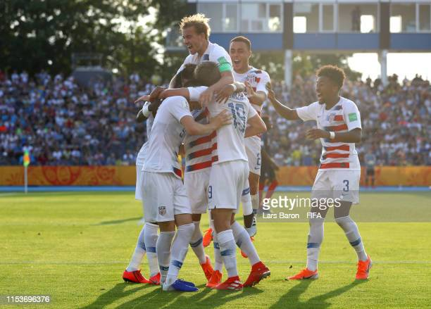 Justin Rennicks of the United States celebrates as he scores his team's third goal with with team mates during the 2019 FIFA U20 World Cup Round of...