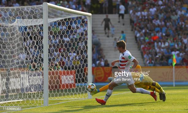 Justin Rennicks of the United States scores his team's third goal past Alban Lafont of France during the 2019 FIFA U20 World Cup Round of 16 match...