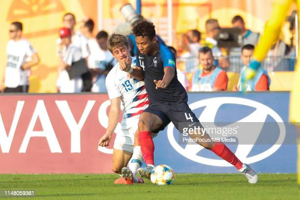 Justin Rennicks of USA competes for the ball with Boubacar Kamara of France during the FIFA U20 World Cup match between France and USA on June 4 2019...