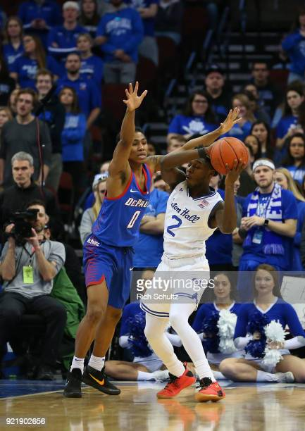Justin Roberts of the DePaul Blue Demons defends Jordan Walker of the Seton Hall Pirates during a game at Prudential Center on February 18 2018 in...