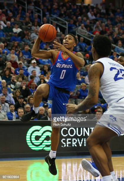 Justin Roberts of the DePaul Blue Demons in action as Desi Rodriguez of the Seton Hall Pirates defends during a game at Prudential Center on February...