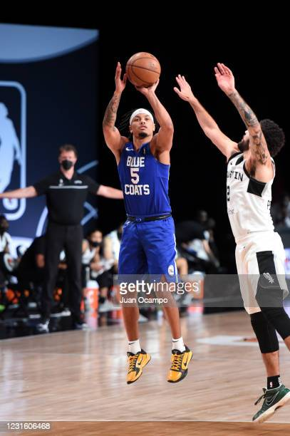 Justin Robinson of the Delaware Blue Coats shoots the ball against the Austin Spurs during the NBA G League Playoffs on March 8, 2021 at AdventHealth...