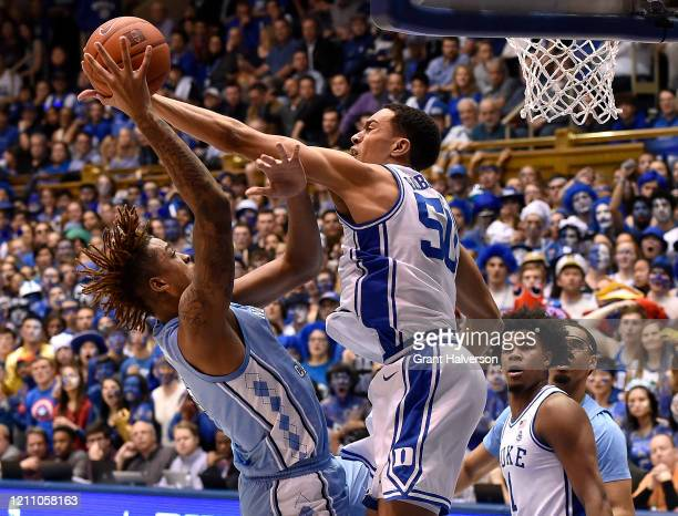 Justin Robinson of the Duke Blue Devils fouls Armando Bacot of the North Carolina Tar Heels during the second half of their game at Cameron Indoor...