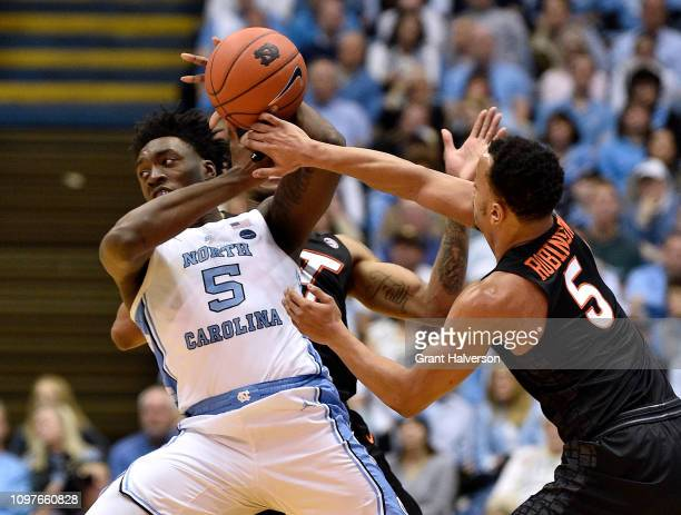 Justin Robinson of the Virginia Tech Hokies battles Nassir Little of the North Carolina Tar Heels for possession during the second half of their game...