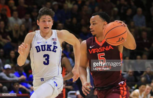 Justin Robinson of the Virginia Tech Hokies dribbles past Grayson Allen of the Duke Blue Devils in the second half at Cassell Coliseum on February 26...