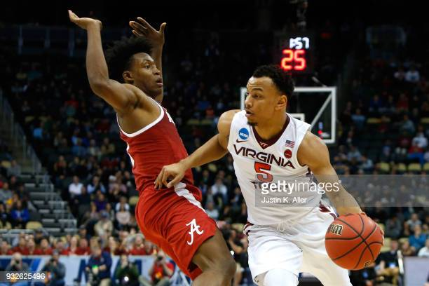 Justin Robinson of the Virginia Tech Hokies drives to the ball against Collin Sexton of the Alabama Crimson Tide late in the second half of the game...