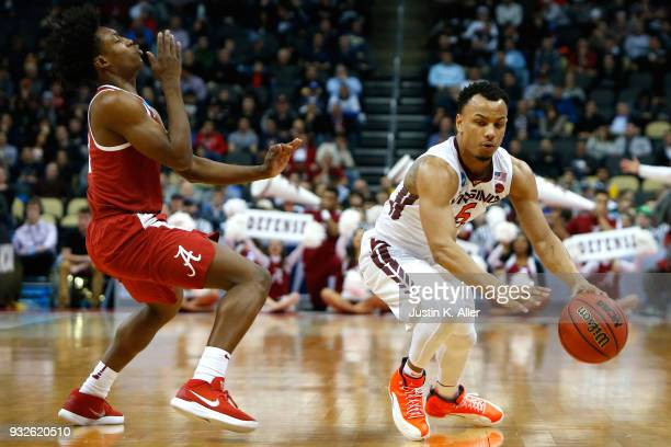 Justin Robinson of the Virginia Tech Hokies fouls Collin Sexton of the Alabama Crimson Tide during the second half of the game in the first round of...