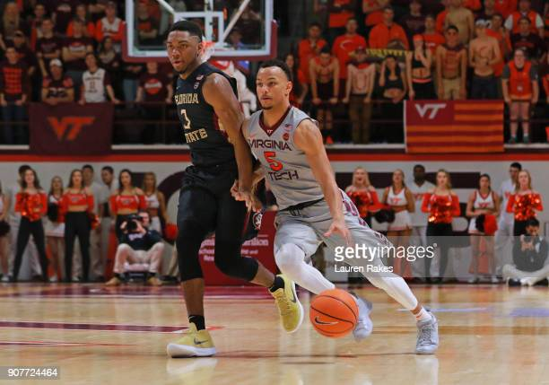 Justin Robinson of the Virginia Tech Hokies runs past Trent Forrest of the Florida State Seminoles in the second half at Cassell Coliseum on January...