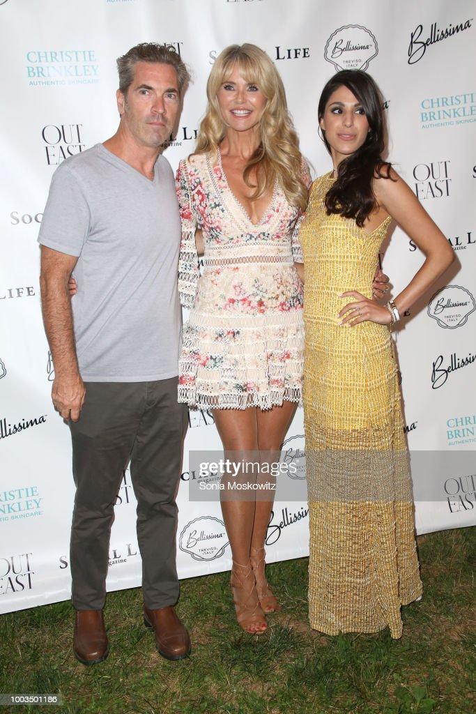 Justin Rose and Christie Brinkley attend the 7th Annual St. Barth Hamptons Gala at Bridgehampton Historical Museum on July 21, 2018 in Bridgehampton, New York.