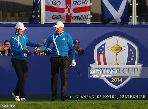 Justin Rose and Henrik Stenson of Europe shake hands as they leave the 1st tee during the Morning Fourballs of the 2014 Ryder Cup on the PGA...