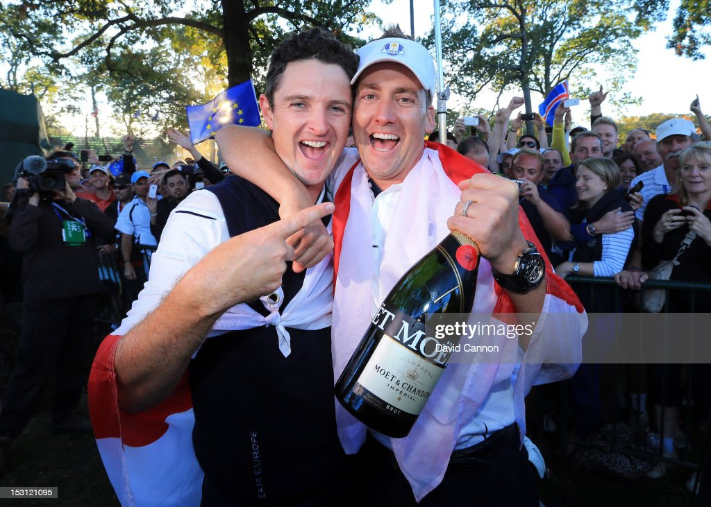 Justin Rose and Ian Poulter celebrate after Europe defeated the USA 14.5 to 13.5 to retain the Ryder Cup during the Singles Matches for The 39th Ryder Cup at Medinah Country Club on September 30, 2012 in Medinah, Illinois.