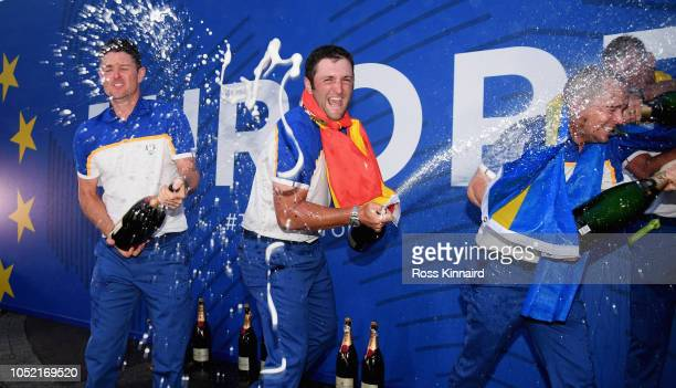Justin Rose and Jon Rahm of Europe celebrate after winning The Ryder Cup during singles matches of the 2018 Ryder Cup at Le Golf National on...