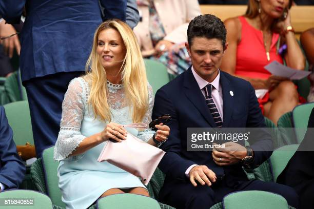 Justin Rose and wife Kate look on from the centre court royal box prior to the Gentlemen's Singles final between Roger Federer of Switzerland and...