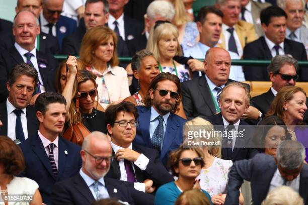 Justin Rose Hugh Grant Michael McIntyre and Bradley Cooper look on the centre court royal box prior to the Gentlemen's Singles final between Roger...