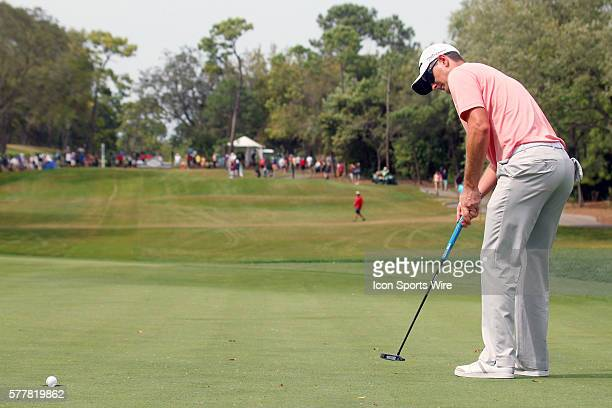 Justin Rose lines up a long putt for a par and then rolls in it on the 8th hole during the final round of the Valspar Championship at Innisbrook...