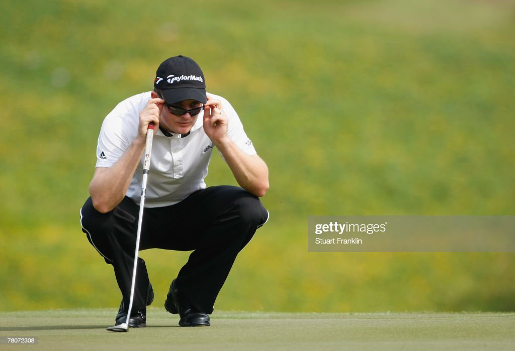 Justin Rose of Engalnd lines up a putt on the fifth hole during the second round of the Omega Mission Hills World Cup at the Mission Hills Golf Resort on November 23, 2007 in Shenzhen, China.