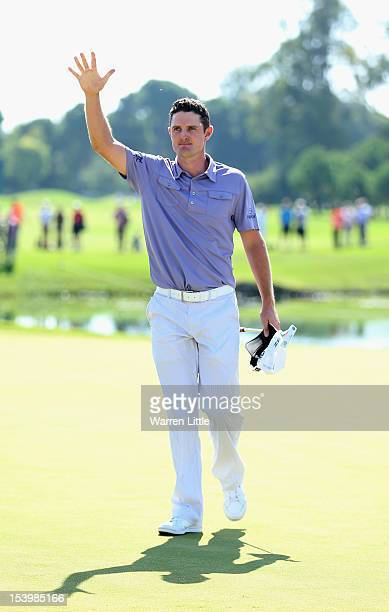 Justin Rose of England acknowledges the crowd after beating fellow countryman Lee Westwood to win the Turkish Airlines World Golf Final final Day at...