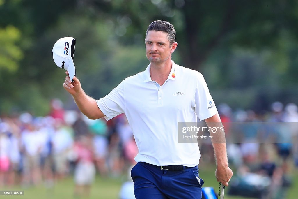 Justin Rose of England acknowledges the crowd as he walks up to the 18th green during the final round of the Fort Worth Invitational at Colonial Country Club on May 27, 2018 in Fort Worth, Texas.
