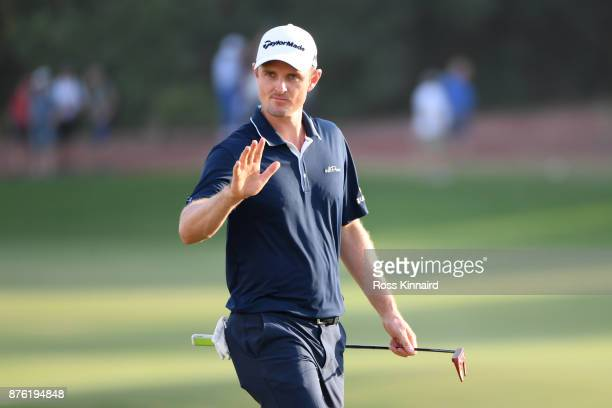 Justin Rose of England acknowledges the crowd on the 18th hole during the final round of the DP World Tour Championship at Jumeirah Golf Estates on...