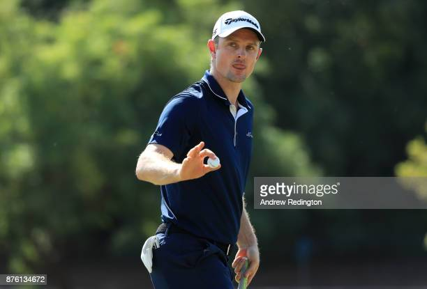 Justin Rose of England acknowledges the crowd on the 3rd green during the final round of the DP World Tour Championship at Jumeirah Golf Estates on...