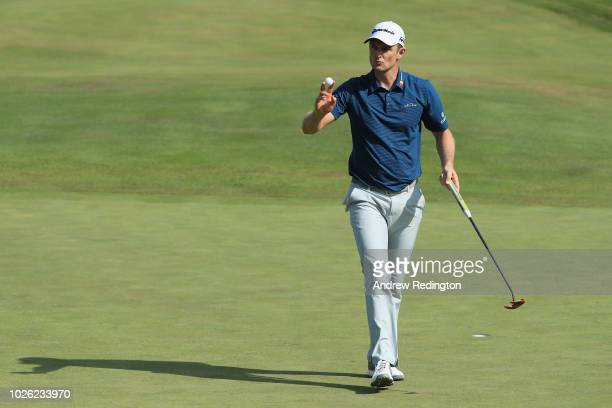 Justin Rose of England acknowledges the crowd on the ninth green during round three of the Dell Technologies Championship at TPC Boston on September...