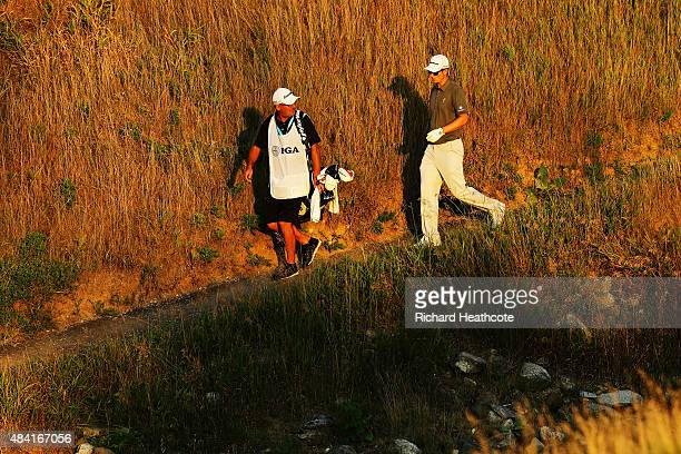 Justin Rose of England and caddie Mark Fulcher on the 18th hole during the third round of the 2015 PGA Championship at Whistling Straits on August 15...