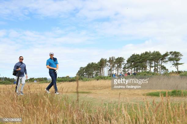 Justin Rose of England and coach Sean Foley on the 14th hole during previews to the 147th Open Championship at Carnoustie Golf Club on July 18 2018...