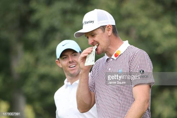Justin Rose of England and Rory McIlroy of Northern Ireland walk off the 18th tee during the first round of the 120th U.S. Open Championship on...