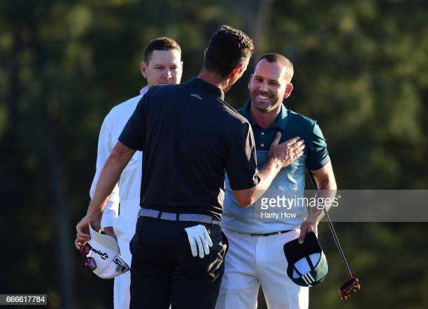 Justin Rose of England and Sergio Garcia of Spain shake hands on the 18th hole before going into a playooff during the final round of the 2017...