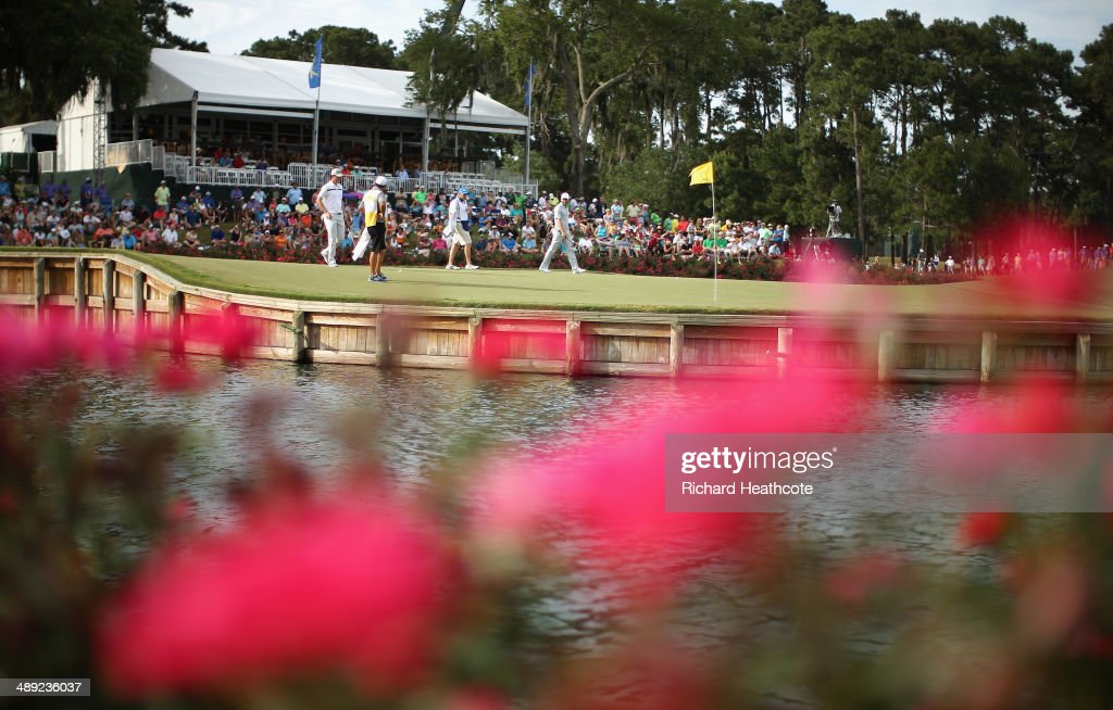 Justin Rose of England and Sergio Garcia of Spain walk to the 17th greenb with their caddies during the third round of THE PLAYERS Championship on the stadium course at TPC Sawgrass on May 10, 2014 in Ponte Vedra Beach, Florida.