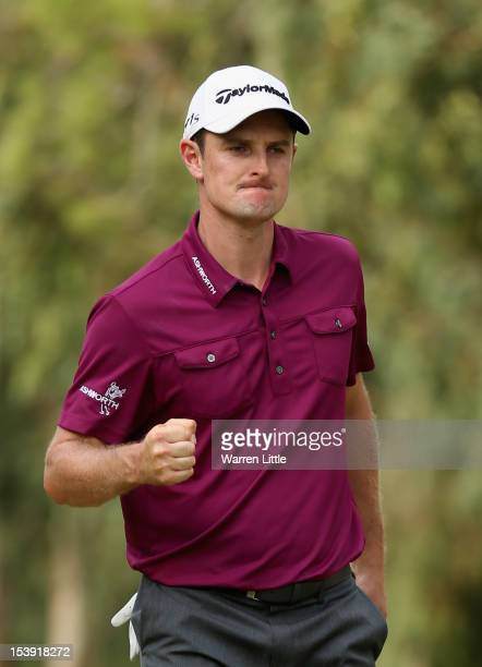 Justin Rose of England celebrates a birdie on the 15th hole against Tiger Woods of the USA during day three of the Turkish Airlines World Golf Final...
