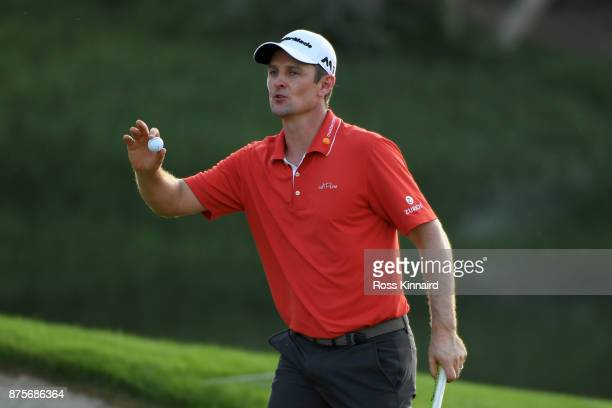 Justin Rose of England celebrates a birdie on the 16th green during the third round of the DP World Tour Championship at Jumeirah Golf Estates on...