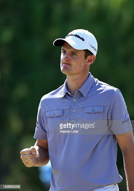 Justin Rose of England celebrates a birdie on the 17th green against fellow countryman Lee Westwood during the final day of the Turkish Airlines...