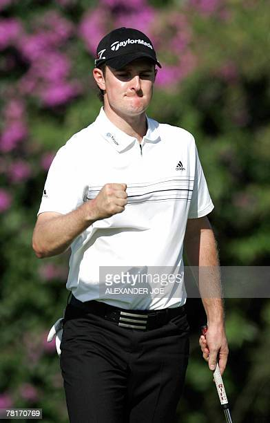 Justin Rose of England celebrates a birdie on the 18th hole on day 2 of Nedbank Golf Challenge in Sun City 30 November 2007 Rose ended the day with...