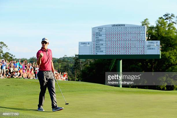 Justin Rose of England celebrates after a birdie putt on the 18th hole during the third round of the 2015 Masters Tournament at Augusta National Golf...