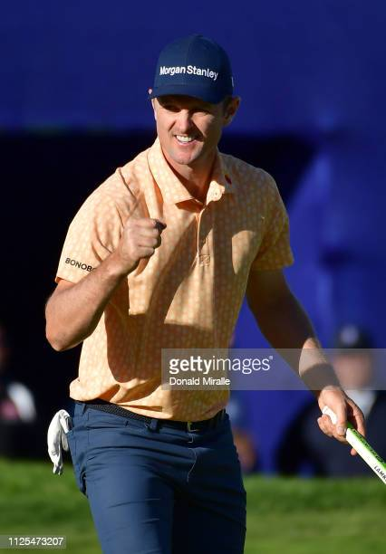 Justin Rose of England celebrates his winning putt on the 18th green on the South Course during the final round of the the 2019 Farmers Insurance...